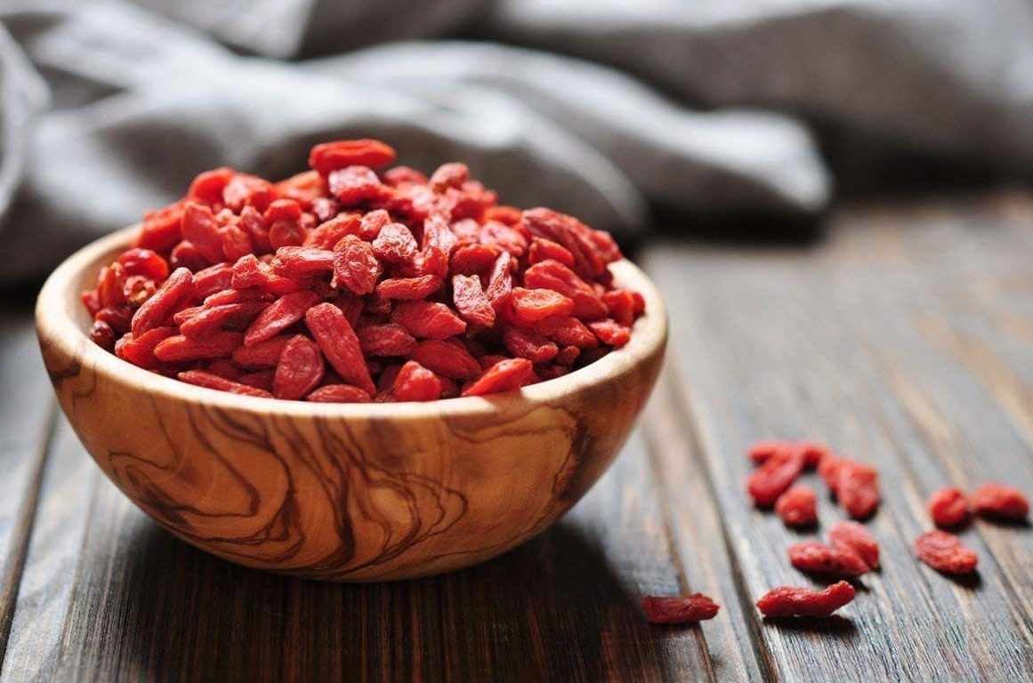 goji berries in a wooden bowl