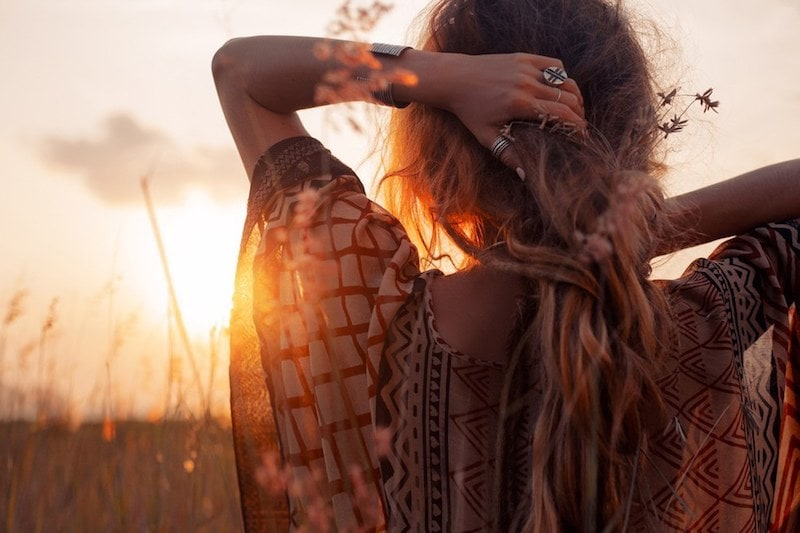 woman looking at sunrise, freedom, empath