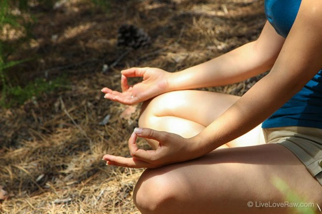 Anya-Andreeva-mudras-meditating-in-a-forest,-yoga,-spirituality
