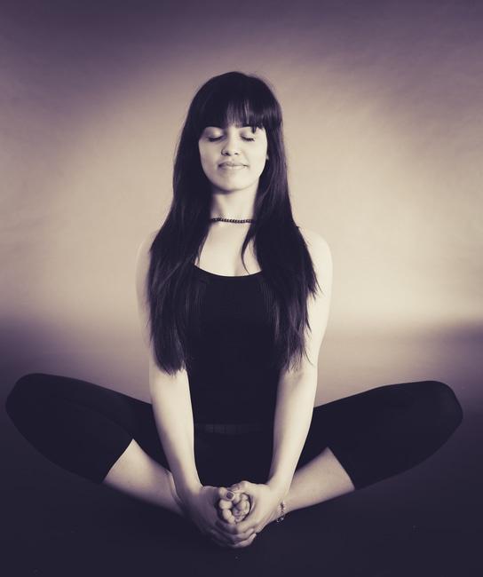 woman meditating black and white
