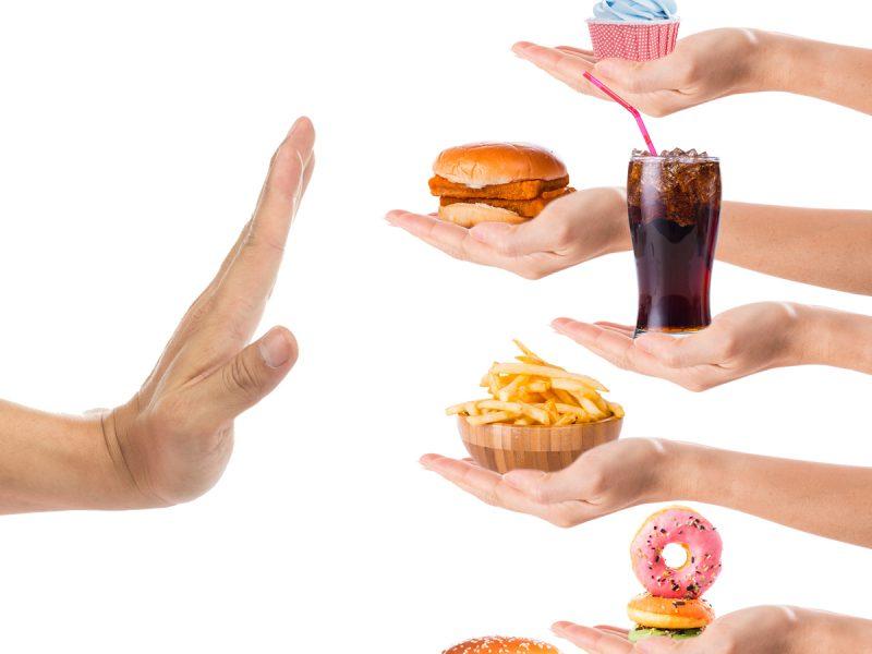 hand saying no to junk food