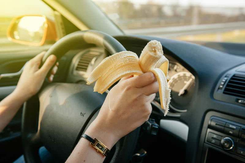 eating raw food whilst driving, banana
