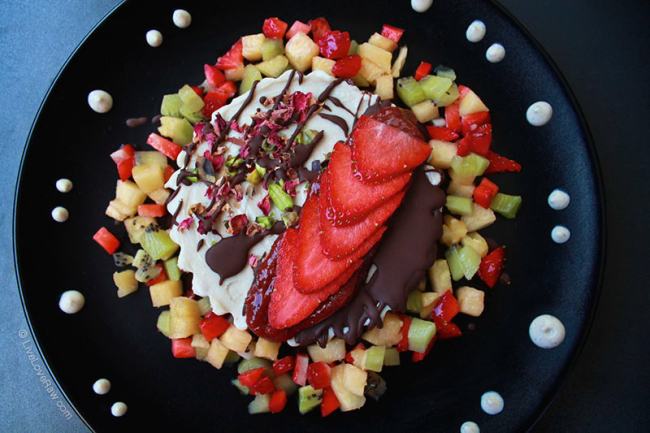 Strawberry no bake cheesecake with fruit from Anya Andreevas raw food kitchen in Marbella, Spain