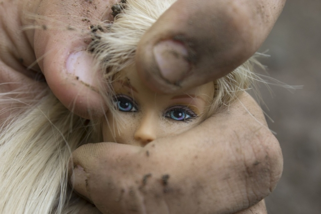barbie-doll-head-being-squeezed-domestic-violence