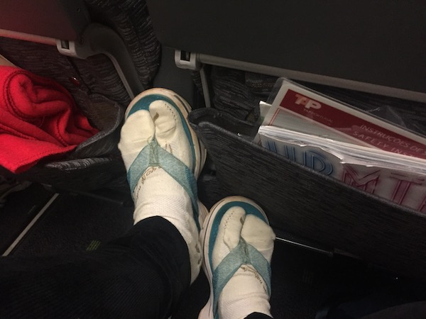 toe socks on plane, travelling tips for girls