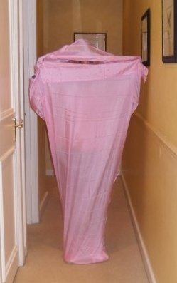 Anya Andreeva in a pink silk sleeping bag