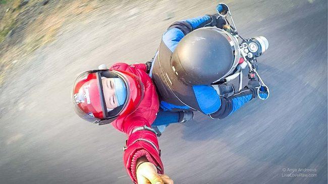 motorbike trip Anya Andreeva and Nitin looking up, Gujarat, India