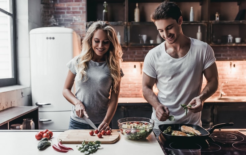 couple in love, cooking dinner together