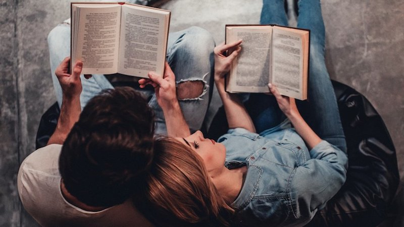 couple reading together in love