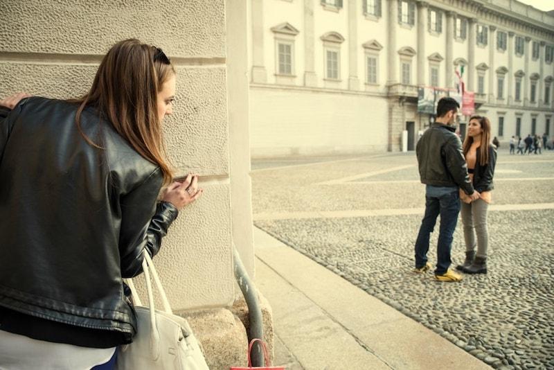 jealous girl spying on her boyfriend