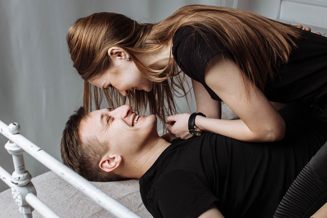 couple in bed laughing, love, smile, hug, romance