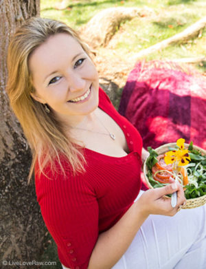 Anya Andreeva, raw vegan chef, sitting with a vegetarian salad in the garden by tree, Live Love Raw