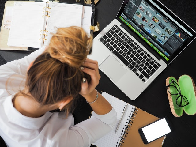 work stress, woman worried by computer