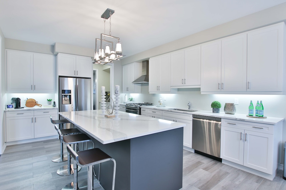white airy kitchen with island